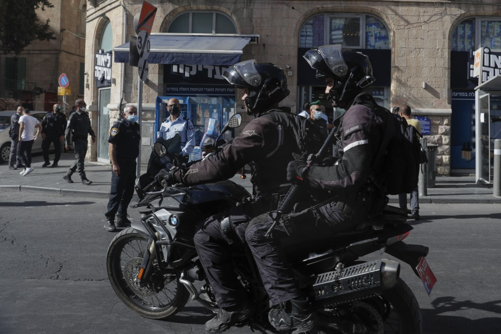 Israeli police arrive to the scene of stabbing attack in Jerusalem's Central Bus Station Monday, Sept. 13, 2021. Israeli paramedics treated two people...