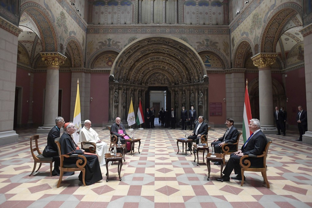 Pope Francis, left, meets Hungarian President Janos Ader, second from right, and Prime Minister Viktor Orban, third from right, at Budapest's Museum o...