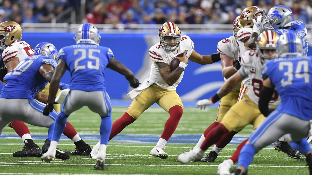 San Francisco 49ers quarterback Trey Lance (5) runs the ball against the Detroit Lions in the second half of an NFL football game in Detroit, Sunday, ...