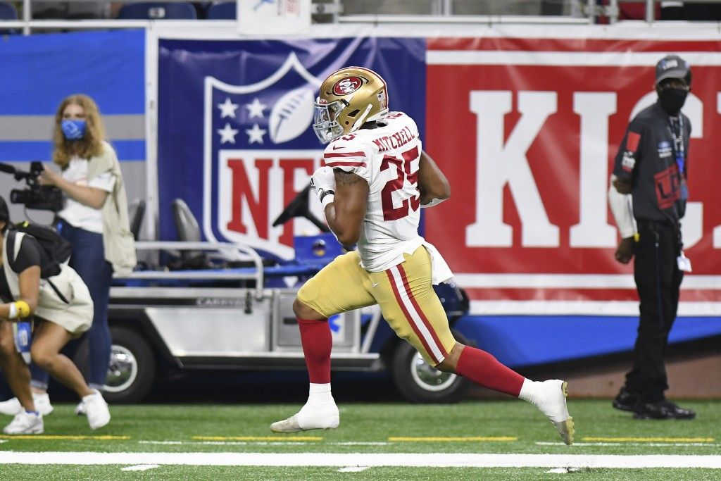 San Francisco 49ers running back Elijah Mitchell runs for a 38-yard touchdown against the San Francisco 49ers in the first half of an NFL football gam...
