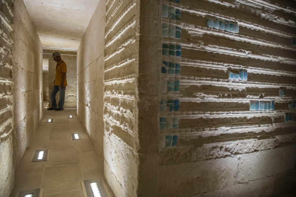 A worker stands inside the southern cemetery of King Djoser, after its restoration, near the famed Step Pyramid, in Saqqara, south of Cairo, Egypt, Tu...