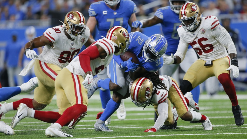 Detroit Lions running back D'Andre Swift (32) runs as San Francisco 49ers defensive back Jason Verrett (2) makes the tackle in the first half of an NF...