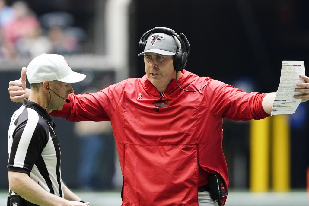 Atlanta Falcons head coach Arthur Smith speaks to an official during the first half of an NFL football game against the Philadelphia Eagles, Sunday, S...