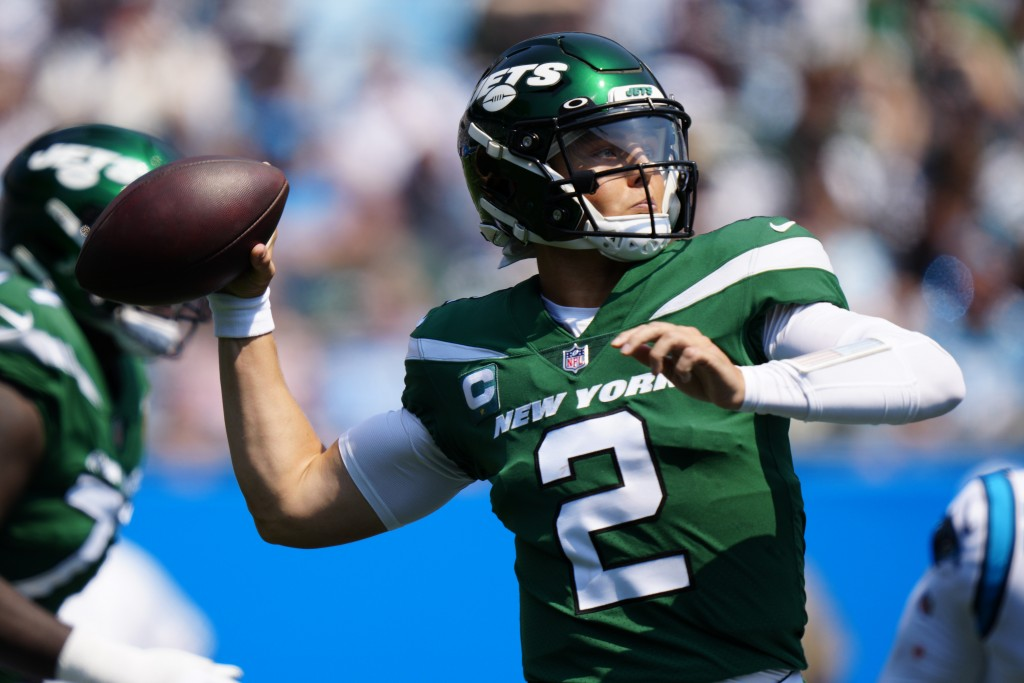New York Jets quarterback Zach Wilson passes against the Carolina Panthers during the first half of an NFL football game Sunday, Sept. 12, 2021, in Ch...