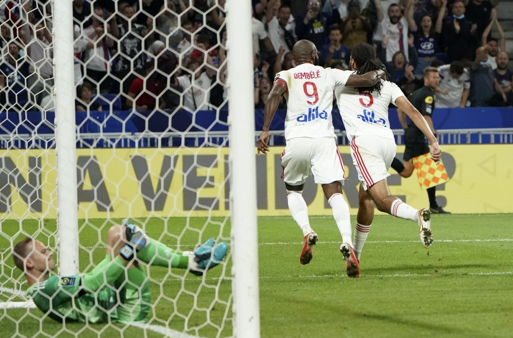 Lyon's Jason Denayer, right, celebrates with Moussa Dembele after scoring his side's second goal during the French League One soccer match between Str...