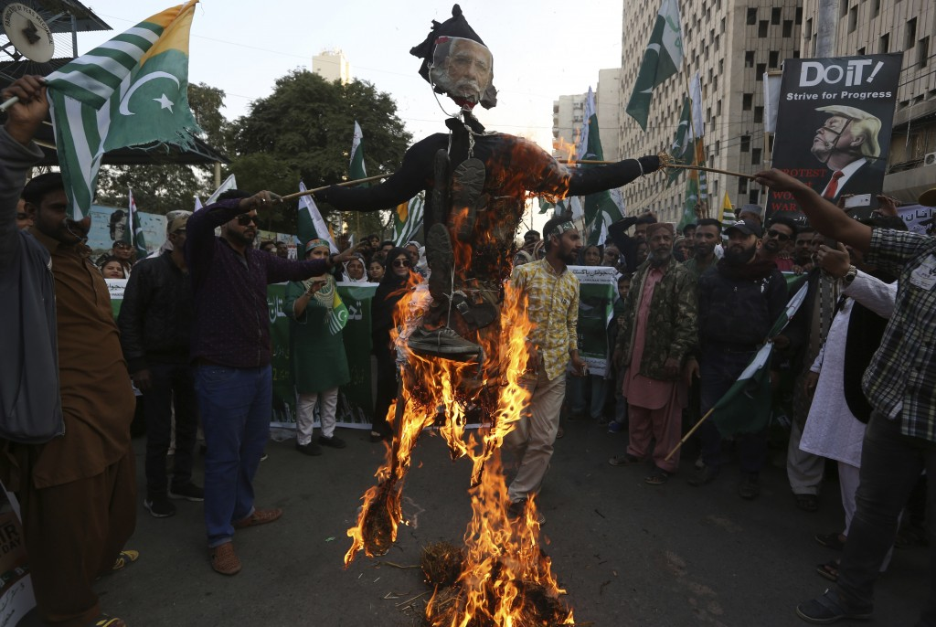 FILE - In this Feb. 5, 2020, file photo, protesters burn an effigy of Indian prime minister during a rally to express solidarity with Indian Kashmiris...
