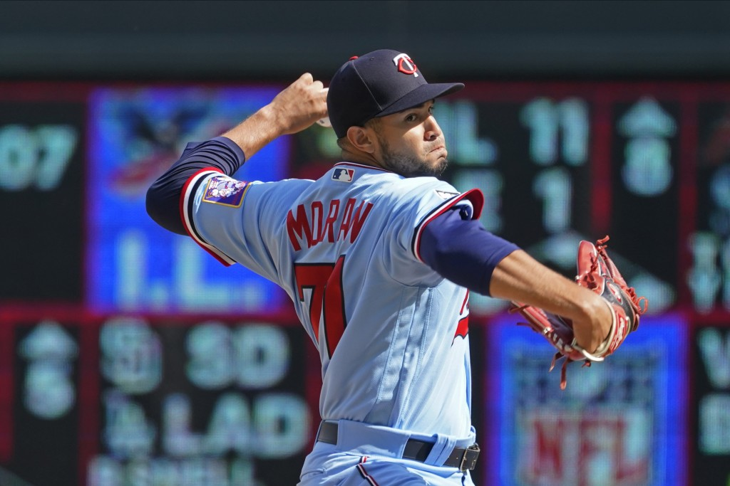 Minnesota Twins pitcher Jovani Moran makes his major league debut as he throws against the Kansas City Royals in the fifth inning of a baseball game, ...