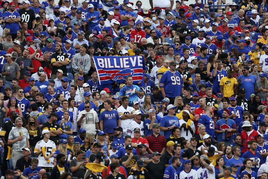 Fans watch the second half of an NFL football game between the Buffalo Bills and the Pittsburgh Steelers in Orchard Park, N.Y., Sunday, Sept. 12, 2021...