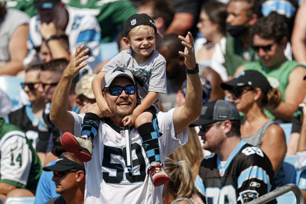 Carolina Panthers fans cheer during the second half of an NFL football game against the New York Jets on Sunday, Sept. 12, 2021, in Charlotte, N.C. (A...