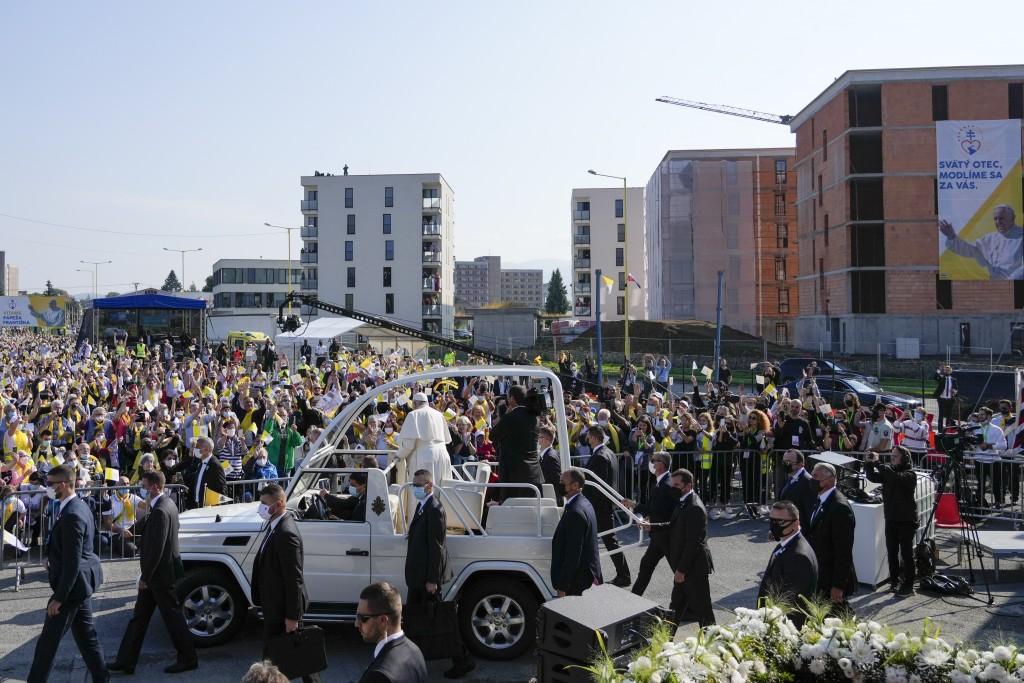 Pope Francis arrives on board his pope-mobile to celebrate a Byzantine rite Mass at Mestska sportova hala Square, in Presov, Slovakia, Tuesday, Sept. ...