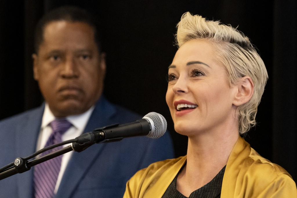 Republican conservative radio talk show host Larry Elder, left, with former actress and activist Rose McGowan, address a news conference at the Luxe H...