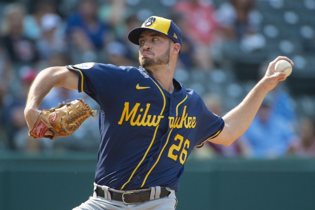 Milwaukee Brewers relief pitcher Aaron Ashby delivers the final pitch, striking out Cleveland Indians' Franmil Reyes, during the ninth inning of a bas...