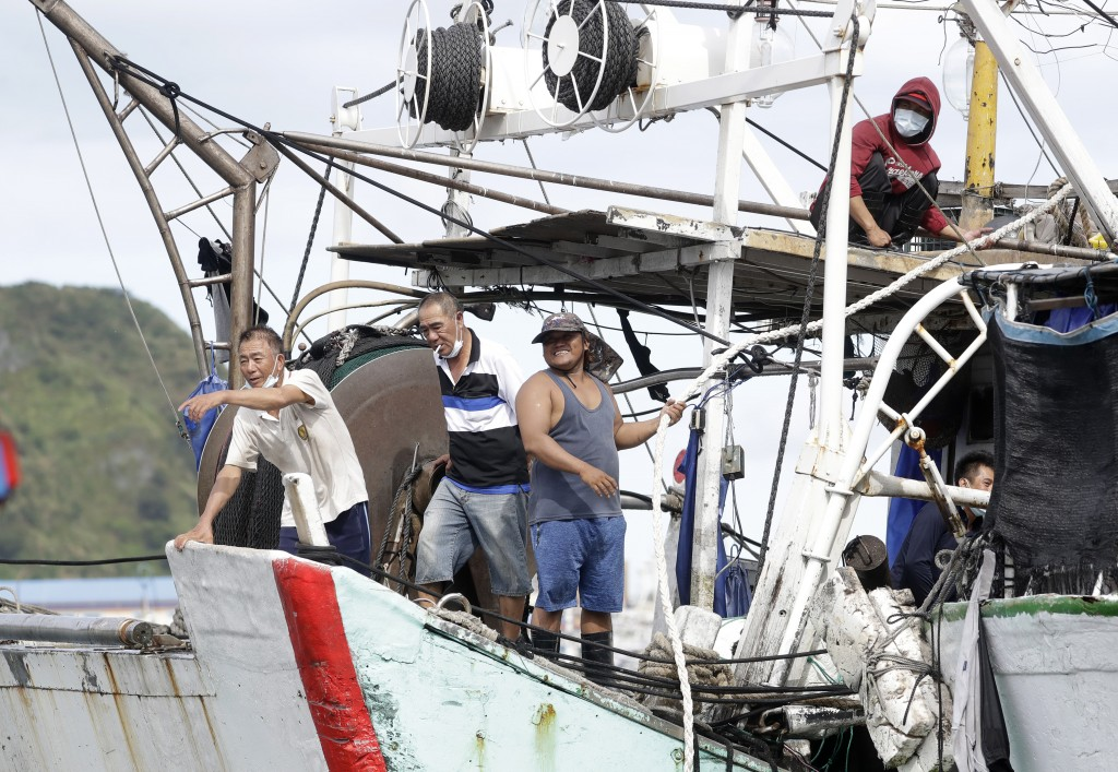 Fishermen fasten a boat to take shelter as Typhoon Chanthu approaches to Taiwan in Keelung, New Taipei City, Taiwan, Saturday, Sept. 11, 2021. Taiwan'...