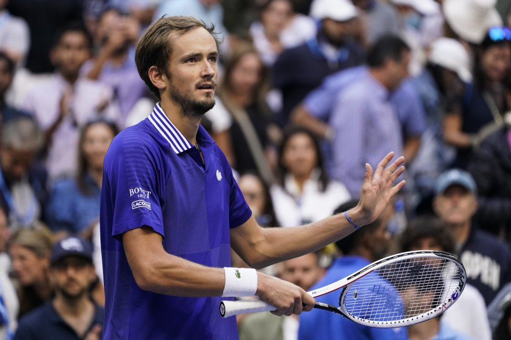 Daniil Medvedev, of Russia, reacts after defeating Felix Auger-Aliassime, of Canada, during the semifinals of the US Open tennis championships, Friday...