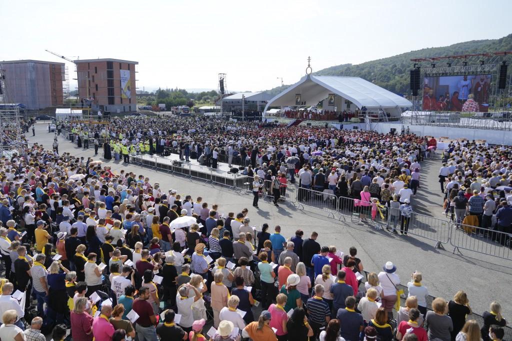 Faithful attend a Byzantine rite Mass celebrated by Pope Francis at Mestska sportova hala Square, in Presov, Slovakia, Tuesday, Sept. 14, 2021. Pope F...