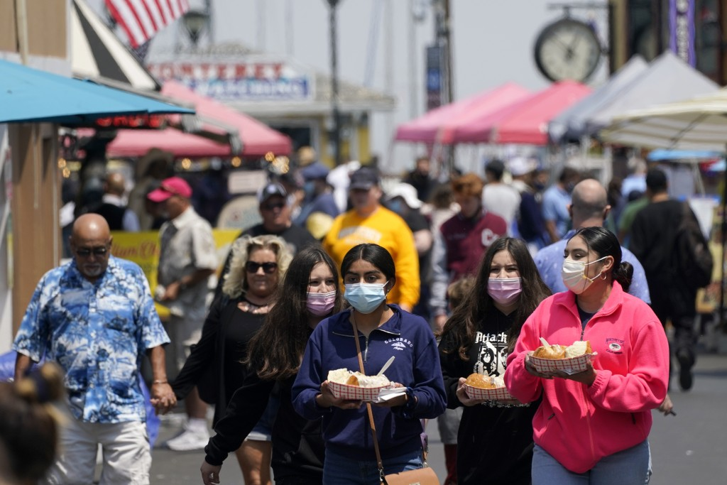 FILE— In this Aug. 9, 2021 file photo people walk along Fisherman's Wharf in Monterey, Calif. Sept. 14 is the last day California voters can cast thei...