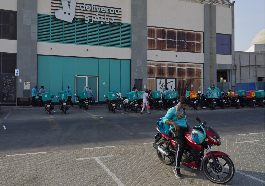 Delivery drivers for the app Deliveroo wait for orders, in Dubai, United Arab Emirates, Thursday, Sept. 9, 2021. Advocates and workers say that casual...