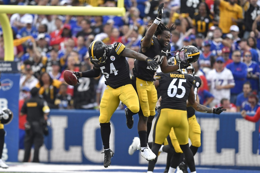 Pittsburgh Steelers linebacker Ulysees Gilbert (54) celebrates with running back Najee Harris (22) after returning a blocked punt for a touchdown duri...