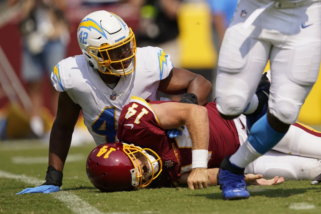 Washington Football Team quarterback Ryan Fitzpatrick (14) reacting after getting tackled by Los Angeles Chargers linebacker Uchenna Nwosu (42) during...