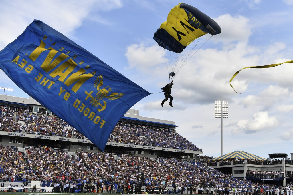 Leap Frogs airmen parachute into the stadium before an NCAA college football game, between Navy and Air Force, Saturday, Sept. 11, 2021, in Annapolis,...