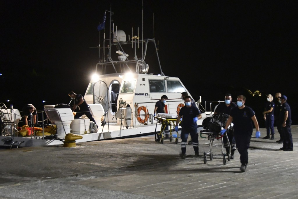 A coast guard vessel arrives with two bodies at Pythagorio port, on the eastern Aegean island of Samos, Greece, late Monday, Sept. 13, 2021. Authoriti...