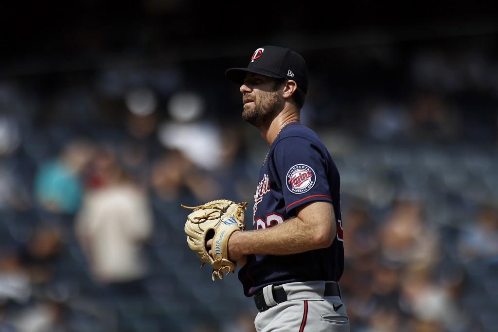 Minnesota Twins pitcher John Gant reacts on the mound against the New York Yankees during the first inning of a baseball game on Monday, Sept. 13, 202...