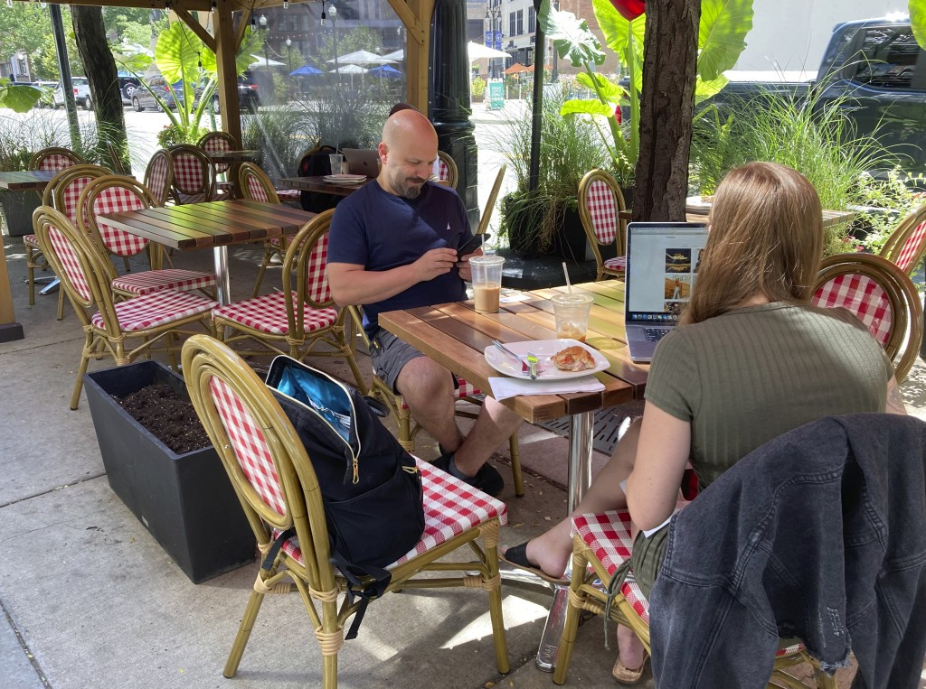 Matt Knio has a conversation while sitting in the outdoor dining area of his eatery Cannelle by Matt Knio in Detroit, Sept. 2, 2021. Downtown business...