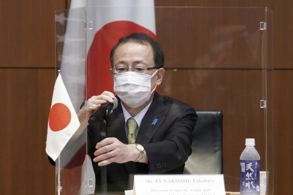 Japanese Foreign Ministry's Director-General of the Asian and Oceanian Affairs Bureau Takehiro Funakoshi prepares to speak during a trilateral meeting...