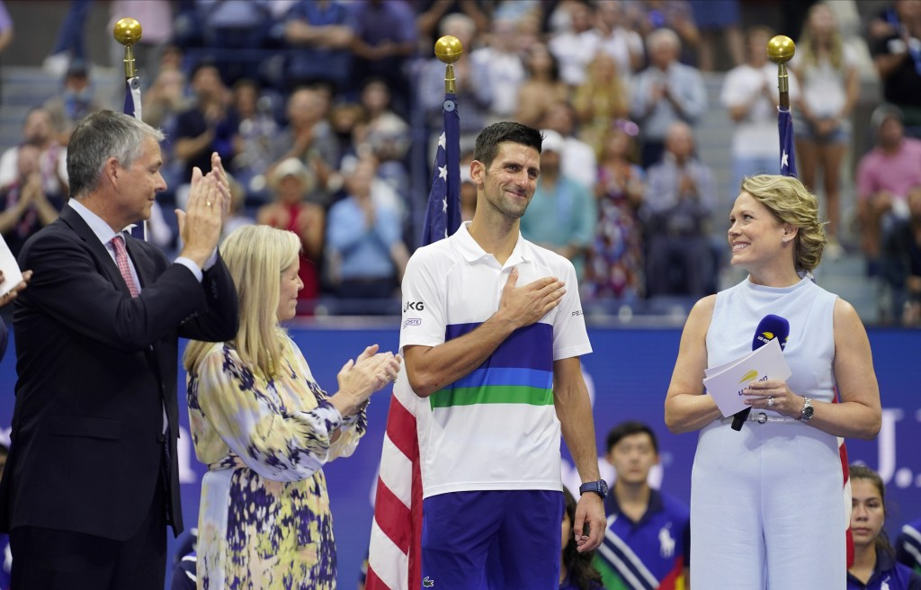 Novak Djokovic, of Serbia, center, reacts while talking to fans after losing to Daniil Medvedev, of Russia, in the men's singles final of the US Open ...