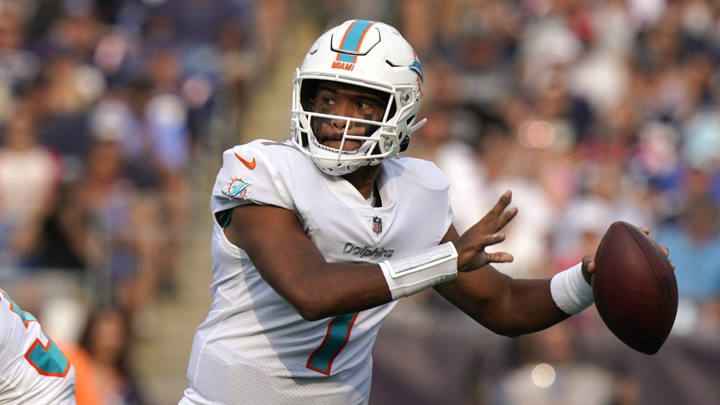 Miami Dolphins quarterback Tua Tagovailoa (1) looks to pass during the first half of an NFL football game against the New England Patriots, Sunday, Se...