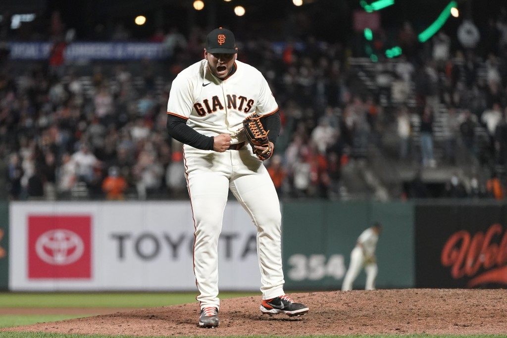 San Francisco Giants pitcher Kervin Castro celebrates after the Giants defeated the San Diego Padres in a baseball game to clinch a postseason berth i...