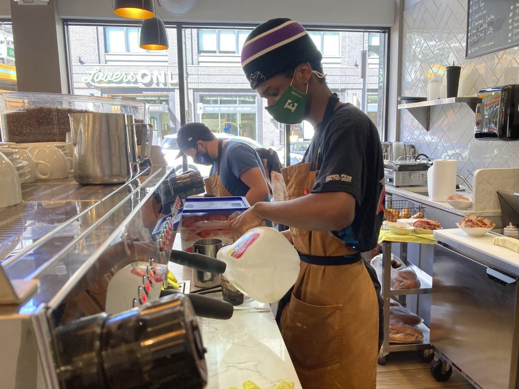 Davion Lyons makes a drink for a customer in the kitchen area of Cannelle by Matt Knio, in Detroit, Sept. 2, 2021. Downtown businesses such as Cannell...