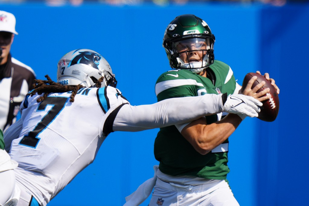 New York Jets quarterback Zach Wilson is sacked by Carolina Panthers outside linebacker Shaq Thompson during the second half of an NFL football game S...