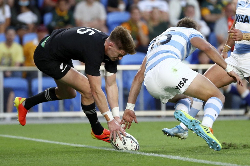 New Zealand's Jordie Barrett, left, touches down in a try attempt against Argentina's Juan Cruz Mallia during their Rugby Championship match on Sunday...