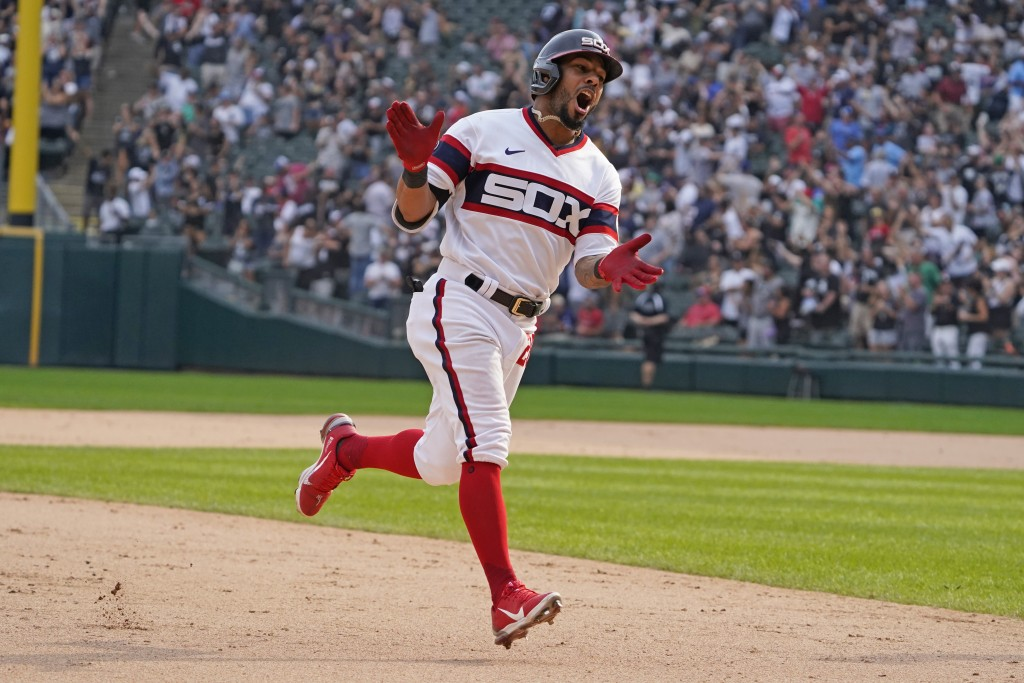 Chicago White Sox' Leury Garcia (28) runs the bases after hitting a walk-off home run during the ninth inning against the Boston Red Sox in a baseball...
