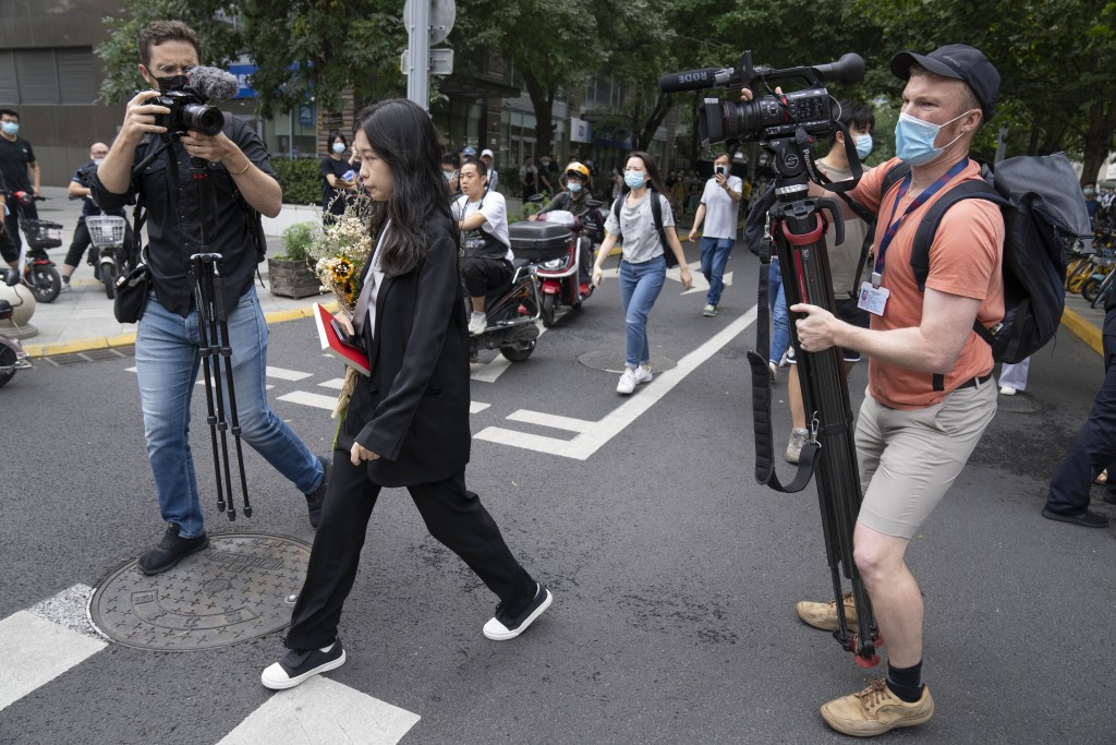 Zhou Xiaoxuan, a former intern at China's state broadcaster CCTV, arrives to attend a court session at a courthouse in Beijing, Tuesday, Sept. 14, 202...