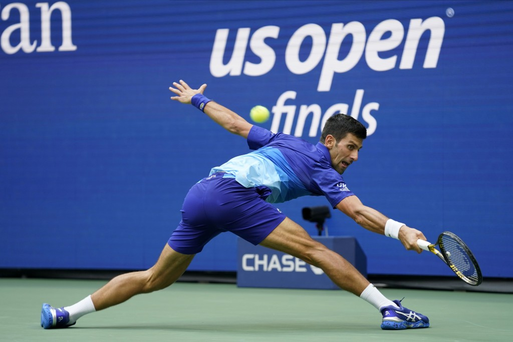 Novak Djokovic, of Serbia, returns a shot to Daniil Medvedev, of Russia, during the men's singles final of the US Open tennis championships, Sunday, S...