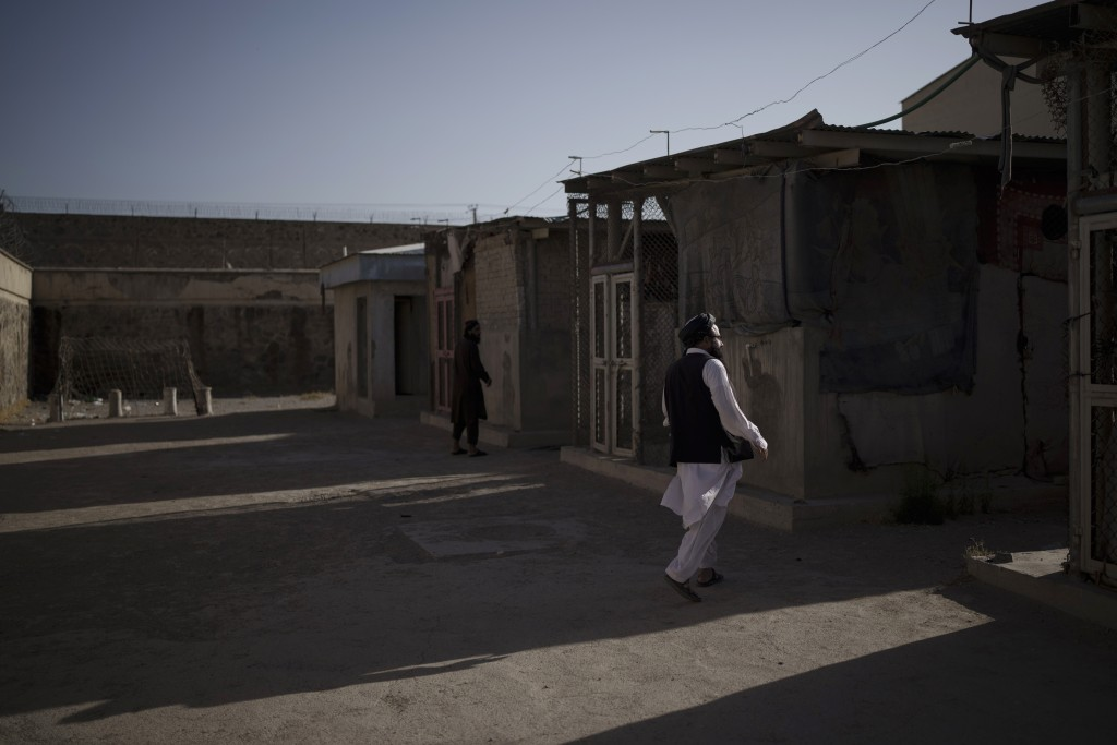 Taliban fighters walk through an empty area of the Pul-e-Charkhi prison in Kabul, Afghanistan, Monday, Sept. 13, 2021. Pul-e-Charkhi was previously th...