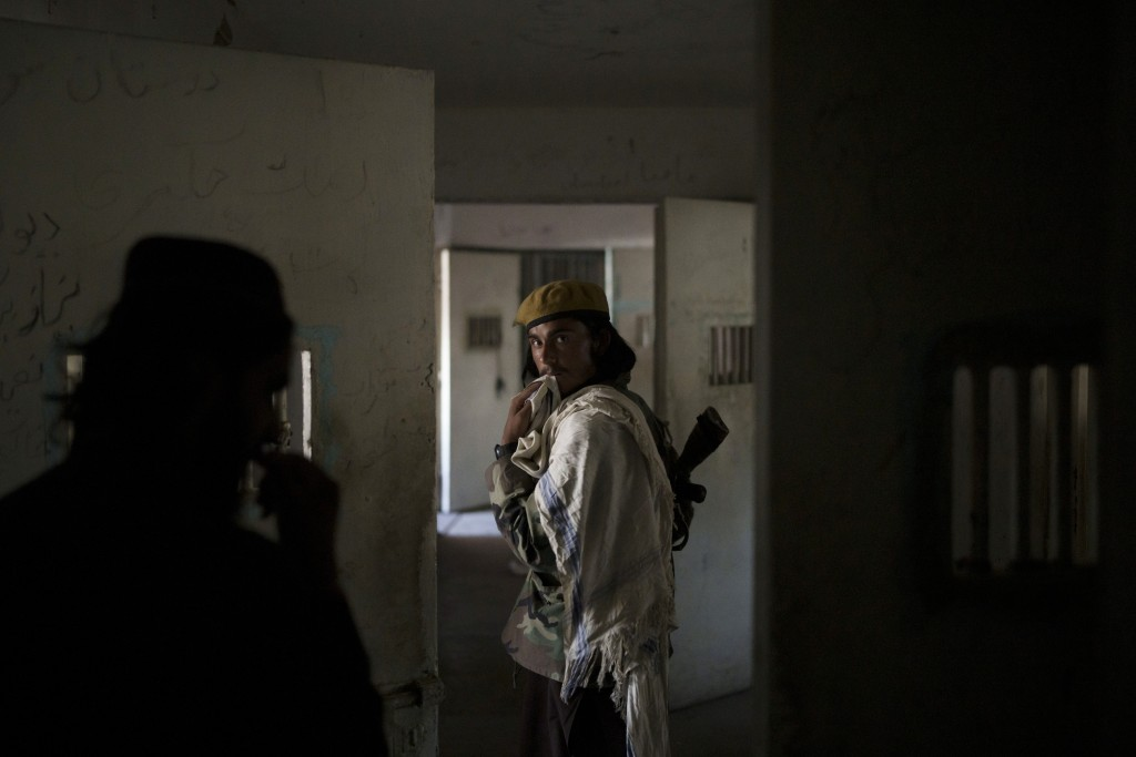 Taliban fighters walk through the alleys of an empty area at the Pul-e-Charkhi prison in Kabul, Afghanistan, Monday, Sept. 13, 2021. Pul-e-Charkhi was...