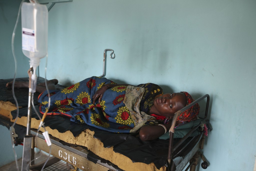 FILE - In this Monday, Sept. 6, 2010 file photo, a Nigerian woman suffering from cholera receives treatment at a village health clinic in Ganjuwa in N...