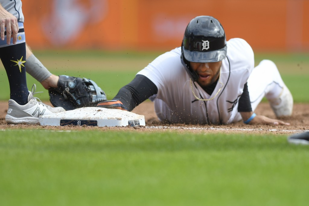 Detroit Tigers' Victor Reyes slides safely back to first base on a pickoff-attempt in the third inning of a baseball game against the Tampa Bay Rays, ...
