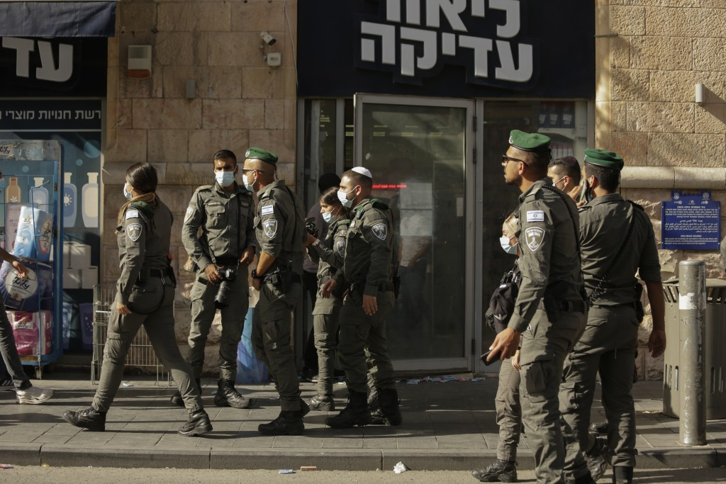 Israeli police inspect the scene of stabbing attack in Jerusalem's Central Bus Station Monday, Sept. 13, 2021. Israeli paramedics treated two people w...