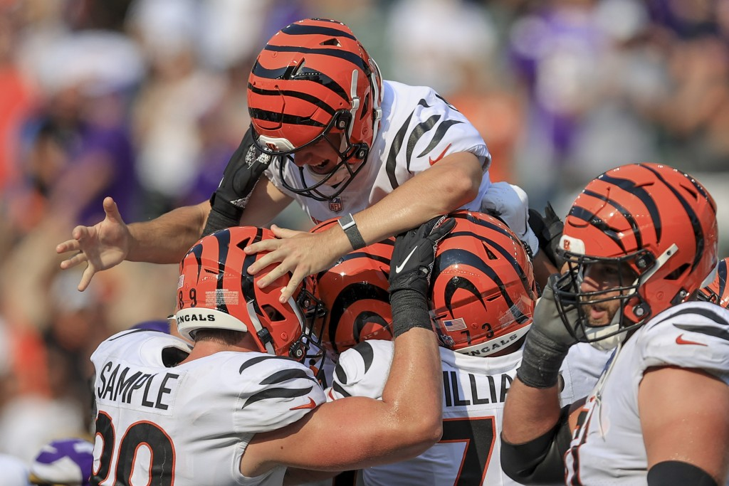 Cincinnati Bengals kicker Evan McPherson (2) is lifted by teammates after hitting a field goal to defeat the Minnesota Vikings during overtime of an N...