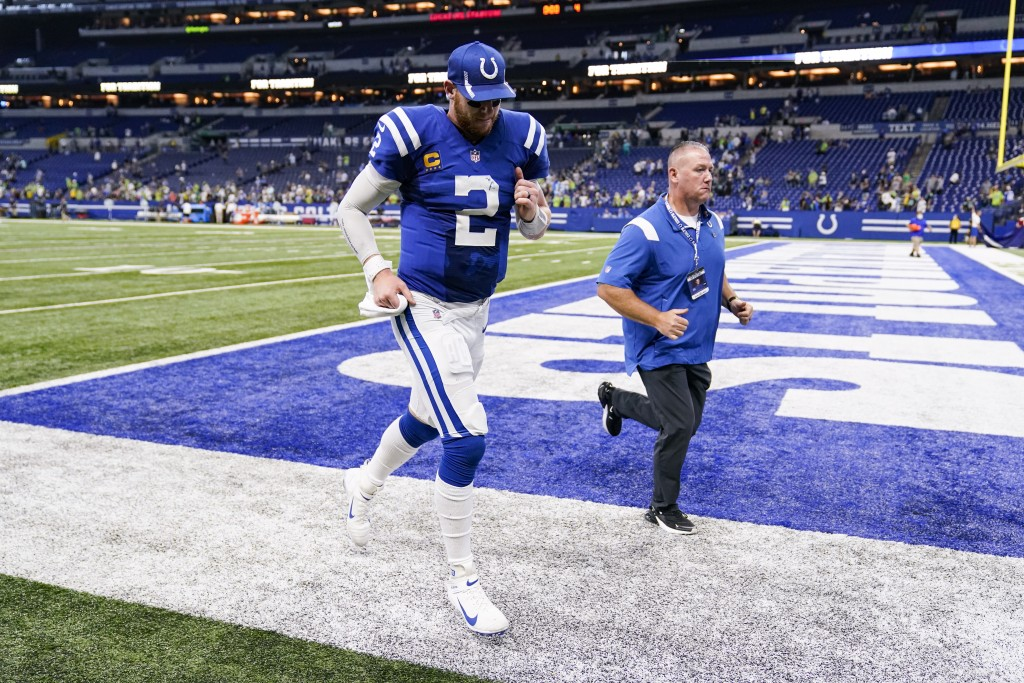 Indianapolis Colts quarterback Carson Wentz (2) runs off the field following a 28-16 loss to the Seattle Seahawks in an NFL football game in Indianapo...