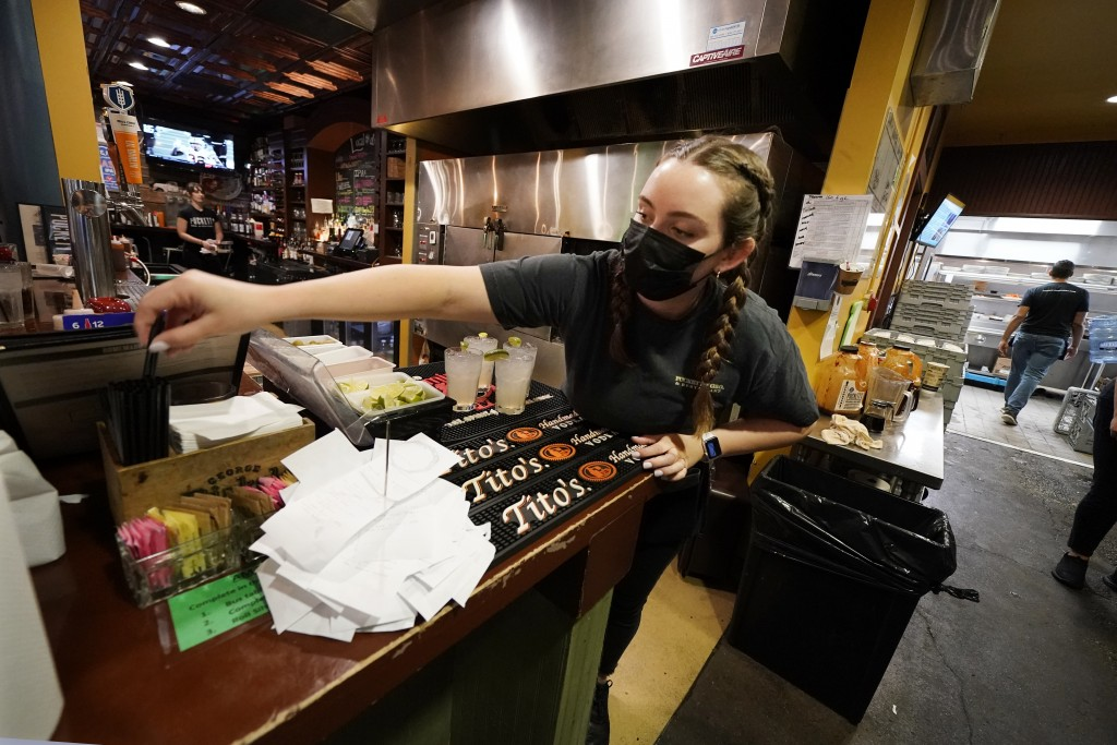 Mariah Tabb prepares drinks at Puckett's Grocery and Restaurant, Friday, Sept. 10, 2021, in Nashville, Tenn. In Nashville, tourism has come back faste...
