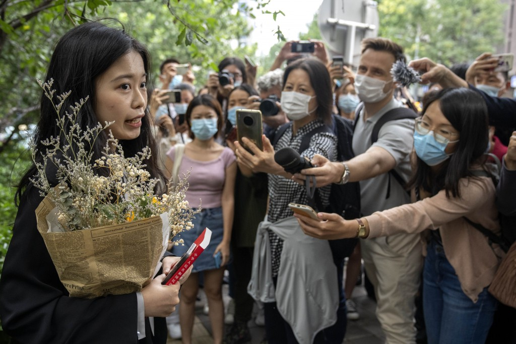 Zhou Xiaoxuan, a former intern at China's state broadcaster CCTV, speaks outside a courthouse before attending a session in her court case against a t...