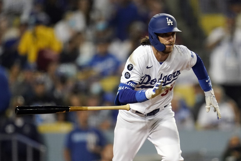 Los Angeles Dodgers' Cody Bellinger drops his bat as he doubles during the seventh inning of a baseball game against the Arizona Diamondbacks Monday, ...