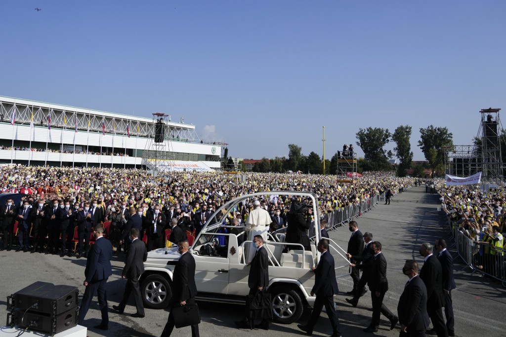 Pope Francis arrives on his pope-mobile, surrounded by security guards, to celebrate a Byzantine rite Mass at Mestska sportova hala Square, in Presov,...