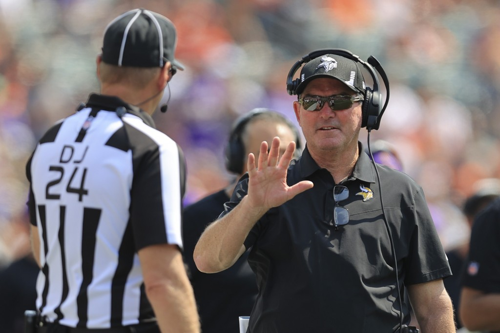 Minnesota Vikings head coach Mike Zimmer talks with an official in the first half of an NFL football game against the Cincinnati Bengals, Sunday, Sept...