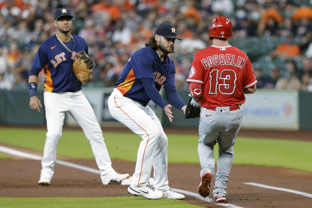 Houston Astros starting pitcher Lance McCullers Jr., middle, makes the tag on Los Angeles Angels left fielder Phil Gosselin (13) on his infield ground...